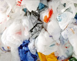 The UK government may extend the plastic shopping bag charge to smaller retailers.